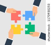 business hands putting puzzle... | Shutterstock . vector #1170930253