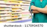 surgeon doctor standing in... | Shutterstock . vector #1170934570