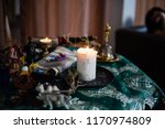 Stock photo shamanic table candles and herbs for rituals close up of religious accessories fit for rituals 1170974809