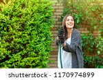 smiling young woman with garden ... | Shutterstock . vector #1170974899