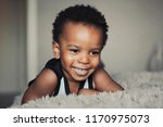 cute african child smiling at... | Shutterstock . vector #1170975073