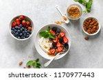 greek plain yogurt with fresh... | Shutterstock . vector #1170977443