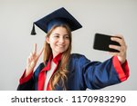 young female student graduating ... | Shutterstock . vector #1170983290