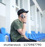 young man talking on the phone   Shutterstock . vector #1170987790