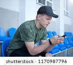 young man checking his phone   Shutterstock . vector #1170987796