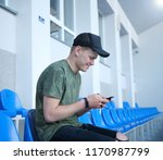 happy man checking his phone   Shutterstock . vector #1170987799