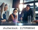 business team sitting in office ... | Shutterstock . vector #1170988060