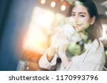 beautiful asian woman enjoy hot ... | Shutterstock . vector #1170993796