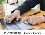 businessman working on laptop...   Shutterstock . vector #1171011799