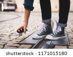 smartphone fell on a cobbled... | Shutterstock . vector #1171015180