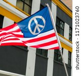 Stock photo an american flag designed with a peace symbol flies during the march for our lives protests in 1171023760