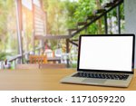 laptop on wooden at home blank... | Shutterstock . vector #1171059220