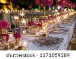 elegant table set with glasses...   Shutterstock . vector #1171059289