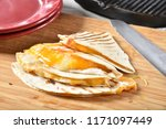 fresh cooked cheese quesadilla... | Shutterstock . vector #1171097449