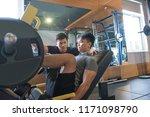 asian man using leg press... | Shutterstock . vector #1171098790