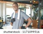 smiling sporty black man... | Shutterstock . vector #1171099516