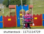 rear view of a child on swing. | Shutterstock . vector #1171114729