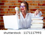 young businesswoman with laptop ... | Shutterstock . vector #1171117993