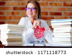 young businesswoman in glasses... | Shutterstock . vector #1171118773