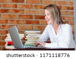 young businesswoman sitting on... | Shutterstock . vector #1171118776