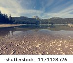crystal clear forest lake... | Shutterstock . vector #1171128526