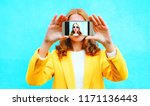 happy girl takes a picture self ... | Shutterstock . vector #1171136443