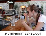 teen is drinking juice at bar... | Shutterstock . vector #117117094