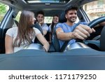 happy friends traveling by car | Shutterstock . vector #1171179250