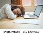 business woman tired a sleep on ... | Shutterstock . vector #1171204069