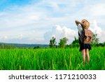 a happy girl enjoying nature in ... | Shutterstock . vector #1171210033