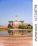 Reflection of a government building in water, Rashtrapati Bhavan, New Delhi, India - stock photo