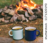 two metal cups with tea. fire... | Shutterstock . vector #1171320193