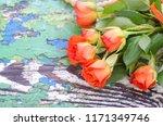 orange roses on a vintage... | Shutterstock . vector #1171349746