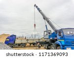 unloading of building materials ...   Shutterstock . vector #1171369093