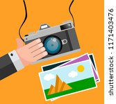 flat design camera hand photo...   Shutterstock .eps vector #1171403476