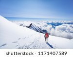 mountaineer enjoing view from...