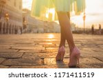 woman walking in old city by... | Shutterstock . vector #1171411519