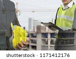 2 male occupational health and... | Shutterstock . vector #1171412176