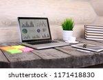 analyzing statistics on laptop...   Shutterstock . vector #1171418830