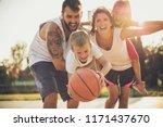 happy basket family portrait.... | Shutterstock . vector #1171437670