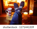 man's feet in warm socks with...   Shutterstock . vector #1171441339