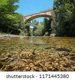 A Bridge Over A River With...