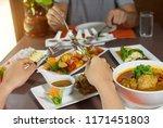 happy couple enjoying food thai ...   Shutterstock . vector #1171451803