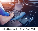 mechanic man with laptop making ... | Shutterstock . vector #1171460743