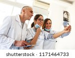 group of dentists examining x... | Shutterstock . vector #1171464733