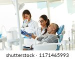 dentist and his assistant in... | Shutterstock . vector #1171465993