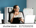 young businesswoman working in... | Shutterstock . vector #1171510153