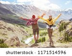 happy couple with raised hands... | Shutterstock . vector #1171514596