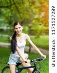 beautiful girl riding a bicycle ... | Shutterstock . vector #1171527289