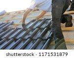 roofing contractors working on... | Shutterstock . vector #1171531879